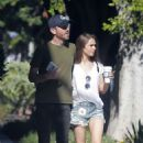 Lily Collins in Jeans Shorts and Charlie Mcdowell – Out in Los Feliz - 454 x 701