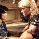 Courteney Cox as Julie Winston in  Masters of the Universe