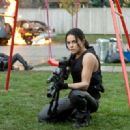 Michelle Rodriguez as Rain in Resident Evil: Retribution