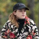 Emma Watson in a mixed print fur coat as she heads to pilates class in London