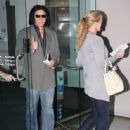 Kiss bassist Gene Simmons and his wife Shannon leave an AT&T store after buying an iPhone 4 on February 2, 2012 in Beverly Hills, CA.