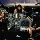 (L-R) Musicians Ozzy Osbourne, Tommy Clufetos and Slash perform onstage at the 10th annual MusiCares MAP Fund Benefit Concert at Club Nokia on May 12, 2014 in Los Angeles, California.