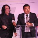 Musician Paul Stanley of KISS and comedian George Lopez attend the 5th Annual Open Hearts Foundation Gala on May 9, 2015 in Malibu, California. - 454 x 319