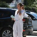 Candice Swanepoel in White Jumpsuit – Out in Brazil