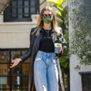 Hailey Bieber – – Seen wearing a leather trench coat and jeans in West Hollywood
