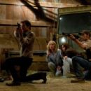 (Left to right.) Timothy Olyphant, Radha Mitchell, Danielle Panabaker and Joe Anderson star in Overture Films´ THE CRAZIES. Photo Credit: Saeed Adyani. © 2010 Overture Films, LLC and Participant Media, LLC. All Rights Reserved. - 454 x 303