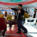 Director J.J. Abrams (center) discusses a scene with actors John Cho (left, as Sulu), Anton Yelchin (center left, as Chekov), Zachary Quinto (center right, as Spock), and Chris Pine (far right, as James T. Kirk) behind-the-scenes of 'Star Trek.' P