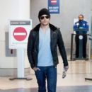 Zac Efron swiftly arrives at LAX (Los Angeles International Airport)