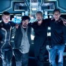 Garrett Hedlund, Steven Lisberger, Jeff Bridges, and Joseph Kosinski on the set of TRON LEGACY