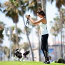 Nina Dobrev with Her Puppy Maverick at a Park in Los Angeles July 6, 2017