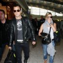 """Horrible Bosses"" star Jennifer Aniston and new beau Justin Theroux are seen arriving at Heathrow Airport together in London. The new couple are seen walking hand in hand as they wear sunglasses while they receive attention"