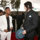 Miguel and Jack White arrive at the 55th Annual GRAMMY Awards on February 10, 2013 in Los Angeles, California