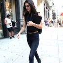Kendall steps out with her modeling portfolio in hand on September 2, 2014 in New York City