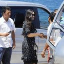 Monica Bellucci seen wearing a black and white polka dot dress while out and about with Paul Higgis in Ischia, Italy