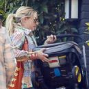 Emma Roberts – Out with her newborn baby boy Rhodes in Los Angeles