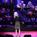 Dolly Parton performs onstage during the 2016 Medallion Ceremony at Country Music Hall of Fame and Museum on October 16, 2016 in Nashville, Tennessee - 454 x 322