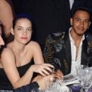 See something you like? Lewis flicks through the auction book as he chats to Barbara Palvin