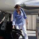 Julia Roberts at Van Nuys airport in Los Angeles, CA with her were hubby Danny Moder and children Hazel and Phinnaeus Moder (July 7)