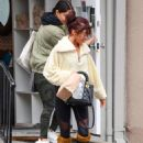 Sarah Hyland in Black Tights and Hunter Wellies Boots – Out and about in Los Angeles