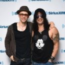 Musicians Myles Kennedy and Slash visit the SiriusXM Studios on May 11, 2015 in New York City.