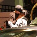 Vanessa Hudgens kisses her boyfriend Austin Butler outside her hotel on March 11, 2012 in Tampa, FL