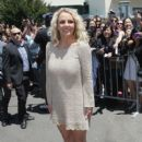 Britney Spears poses for photos after arriving at ORACLE Arena on June 18, 2012 in Oakland, California