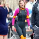 "AnnaLynne McCord dons a wetsuit and gets into the chilly water as she films a surfing scene with a male co-star for ""90210"" in LA"