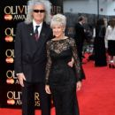 Brian May and Anita Dobson attend The Olivier Awards at The Royal Opera House on April 12, 2015 in London, England. - 425 x 600