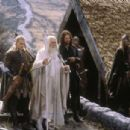 (left and right) Legolas (Orlando Bloom) and Aragorn (Viggo Mortensen) escort Gandalf (Ian McKellen) to the stables of Edoras in New Line Cinema's epic adventure, The Lord of the Rings: The Return of the King.