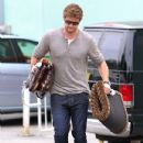 Liam Hemsworth had his hands filled with goodies as he departed a pet store in Studio City yesterday, May 1