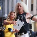 Dee Snider of Twisted Sister on stage with host Elisabeth Hasselbeck during 'FOX & Friends' All American Concert Series outside of FOX Studios on July 25, 2014 in New York City - 428 x 594