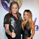 Suzanne Le and Sebastian Bach at Criss Angel's HELP Charity Event Benefiting Pediatric Cancer Research and Treatment on September 12, 2016 in Las Vegas, NV - 401 x 600