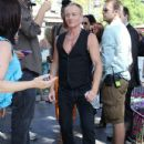 Joe Elliott, Phil Collen and Vivian Campbell of Def Leppard appear for a performance and interview with Mario Lopez of 'Extra' at The Grove, California on June 1st, 2012 - 432 x 594