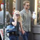 A smitten looking Dakota Fanning and her boyfriend Jamie Strachan go hand in hand for a stroll around New York City - 347 x 594