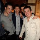 James Jagger, Mick Jagger, William Meredith and Shane Richie pose backstage following ''Lone Star & PVT. Wars'' at the King's Head Theatre on September 5, 2007 in London, England - 400 x 594