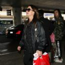 Kyle Richards is arriving from a flight Friday, October 14, 2016 Los Angeles Int'l Airport (LAX) - 400 x 600