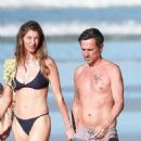 Gisele Bundchen in Black Bikini – Takes a Morning Walk on the Beach in Costa Rica - 454 x 927