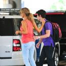 Nick Jonas landed at Los Angeles International Airport on June 24 where he was picked up by girlfriend, Delta Goodrem