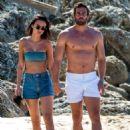 Lucy Watson in Bikini Top and Shorts on the beach in Barbados - 454 x 615