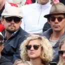 Leonardo DiCaprio and his friend Lukas Haas attend the French tennis Open round of 16 match at the Roland Garros stadium in Paris. Jo-Wilfried Tsonga of France plays against Viktor Troicki of Serbia, and Roger Federer of Switzerland over Gilles Simon of F - 454 x 321