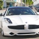 Joe and Kevin Jonas leave Kings Road Cafe and get into Nick's $96,000 white Fisker Karma