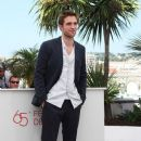 "Robert Pattinson at a photocall for the film ""Cosmopolis"" at the 65th Cannes International Film Festival"