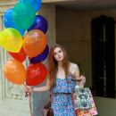 Holland Roden Carrying Balloons