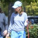 Calista Flockhart with her dogs out in Brentwood - 454 x 655