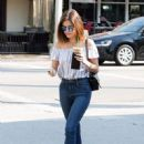 Actress and singer Lucy Hale stops by Starbucks in Los Angeles, California to pick up an iced coffee on August 24, 2016 - 451 x 600