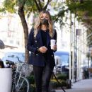 Kelly Bensimon – With her pup out for a coffee in NYC