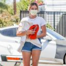 Margot Robbie – In denim shorts visits an office in Santa Monica