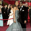 Puff Daddy and Kim Porter