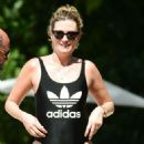Rhea Durham in Black Adidas Swimsuit at the beach in Barbados - 454 x 846