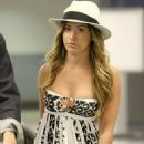 Ashley Tisdale busts out of a revealing key-hole dress as she jets back from Mexican